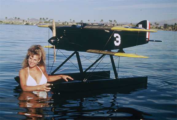 Beautiful Girl with the Curtiss R3C-2 in the water