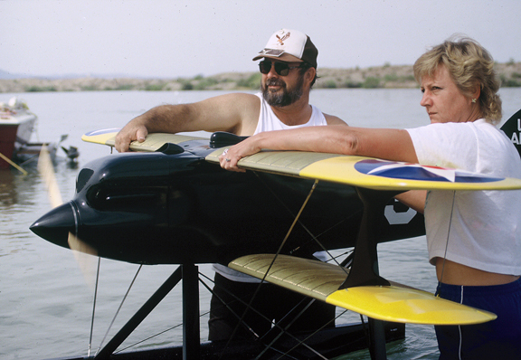 Larry Tate and Katie Martin holding the Curtiss